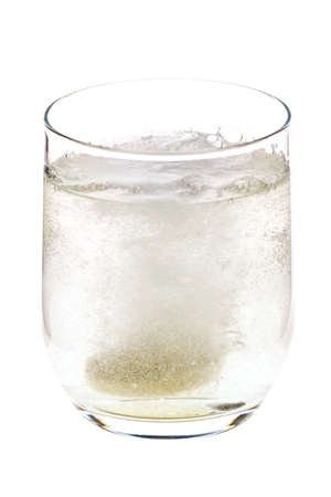 bubble acid: Fizzing pill tossed into the glass, dissolving and releasing bubbles, isolated on white background