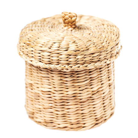Light brown wicker basket with closed lid, isolated on white background photo