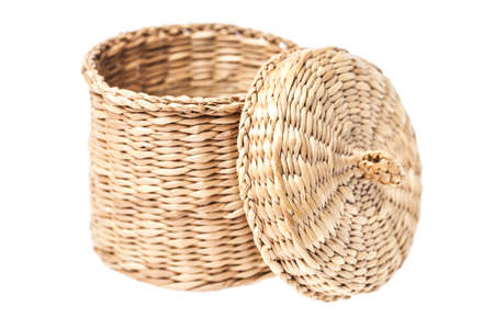 Light brown wicker basket with open lid, isolated on white background Stock Photo - 21973894