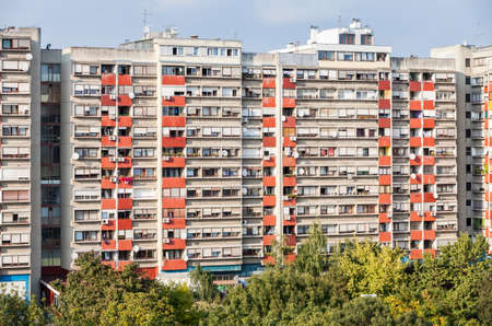 Facade of the reseidential building with windows and balconies and satelite antennas and air conditioners mounted on the facade, in residential neighbourhood of Zagreb, Croatia photo
