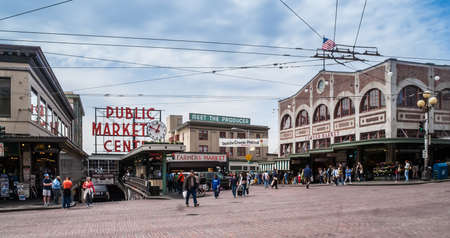 the place is outdoor: Pike Place Public Market entrance on May 18, 2007 in Seattle  Market opened in 1907 and is one of oldest continually operated public markets in US, with 10 million visitors a year  Editorial