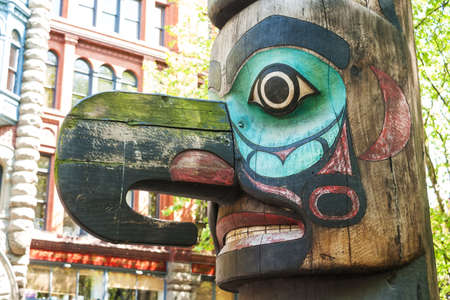 Face of Tlingit totem pole on Pioneer Square on May 19, 2007 in Seattle, Washington  Pioneer Square was city center where founders settled in 1852  Editorial