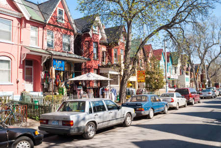 row of houses: Houses and shops in Kensington on May 2, 2007 in Toronto  Kensington Market is a  multicultural neighbourhood in the city and was  proclaimed a National Historic Site of Canada in November 2006  Editorial