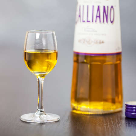 A shot of Galliano liqueur next to the bottle  It was created in 1896 in Italy and is sweet herbal liqueur of many natural ingredients, eg  vanilla, star anise, ginger, citrus, juniper, lavander