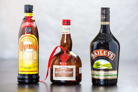 Bottles of coffee liqueur Kahlua, triple sec Grand Marnier and Bailey s Irish Cream, which in equal parts form B-52 cocktail, usually served layered in shot glass