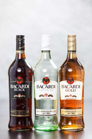 Bacardi Black, White and Gold are rums made by the Bacardi Company  They are used mostly to make cocktails such as Cuba Libre, Daiquiri or Pina Colada  Reklamní fotografie - 24853752
