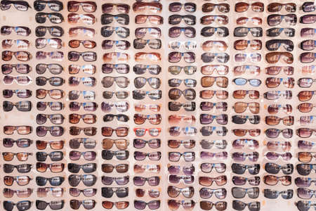 Sunglasses on display offered to tourists and visitors on the market of streets of Zadar, Croatia  reflection of landmarks visible in the glass  in the summer