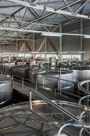 Interior of winery  Belje , a modern winery worth 20 million Euros, with more than 200 chrome tanks for holding wine and capacity of 8 million liters