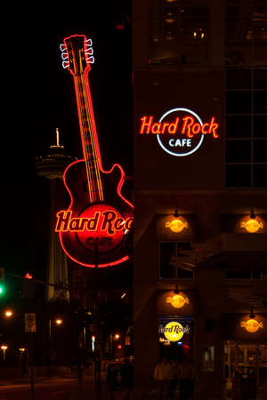 Neon sign of famous Hard Rock Cafe Guitar on display  Apart from being a restaurant, the Hard Rock Cafe is a museum with collection of legacy of rock   roll
