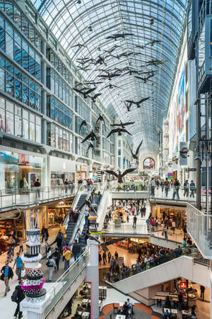 Toronto Eaton Center is shopping centre and office complex in downtown Toronto that provides store directories, special events, leasing information and tenant services  The sculpture of birds is by artist Michael Snow  Editorial