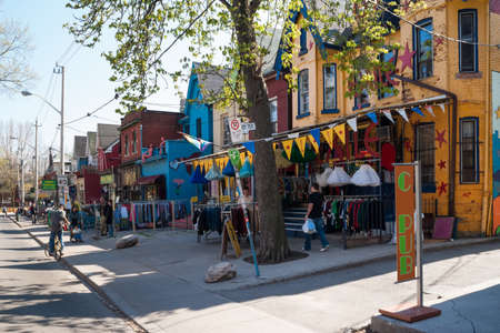 proclaimed: Houses and shops in Kensington in Toronto  Kensington Market is a  multicultural neighbourhood in the city and was  proclaimed a National Historic Site of Canada in November 2006
