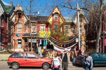 Houses and shops in Kensington in Toronto  Kensington Market is a  multicultural neighbourhood in the city and was  proclaimed a National Historic Site of Canada in November 2006  Reklamní fotografie - 25220755