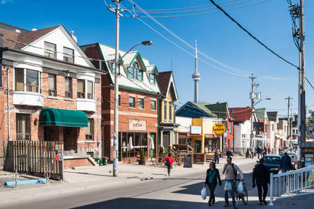 Houses on College Street West, a district in Toronto, Ontario, also known as Little Italy, renowned for its numerous Italian Canadian restaurants and businesses   Editorial