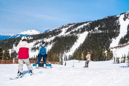 boarders: Unidentified skiers and boarders skiing and boarding on Whistler  Whistler is visited by over 2 million people each year for skiing in winter and mountain biking during summer