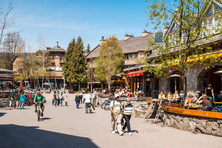 ski walking: Tourists and visitors at the Whistler Ski Resort, Canada  Whistler is visited by over 2 million people each year for skiing during winter and mountain biking during summer