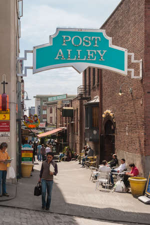 pike place market sign: Post Alley under Pike Place Public Market, one of the oldest continually operated public markets in the US