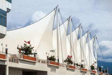 roberts: VANCOUVER, CANADA - MAY 16, 2007: Roof of Canada Place in Vancouver downtown. Canada Place building exterior is covered by fabric roofs resembling sails and was designed by Zeidler Roberts Partnership.
