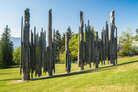elevation meter: VANCOUVER, CANADA - MAY 22, 2007: Totem poles in Burnaby Mountain Park in Burnaby. The Burnaby Mountain is a 1214 foot (370 meter) elevation that overlooks a coastal fjord called the Burrard inlet.
