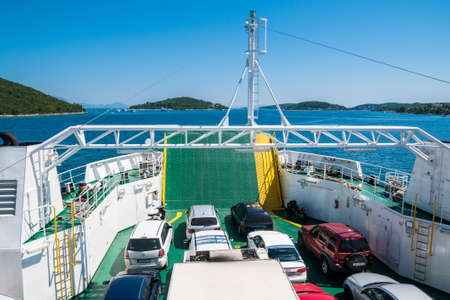 ADRIATIC SEA, CROATIA - AUGUST 13, 2010. Cars on a Jadrolinija company car ferry sailing between Korcula and Peljesac in Adriatic Sea. Jadrolinija is state-owned with main mission in connecting Croatian islands to the mainland by operating passenger and c