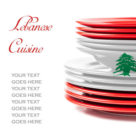 lebanese food: Stack of colorful ceramics plates on white background in white and red, colors of Lebanese flag, illustrating concept of Lebanese food and cuisine