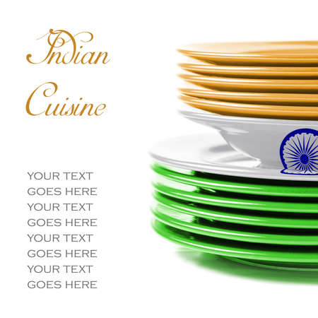 ukraine flag: Stack of colorful ceramics plates on white background in orange, white and green, colors of Indian flag, illustrating concept of Indian food and cuisine