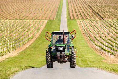 3rd century: Farmer driving tractor through the vineyard near Ilok  The fertile soil in region produces some of the best wine in Eastern Europe ever since the 3rd century A D