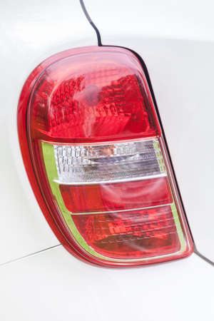 Closeup of the red rear lights of a white car Stock Photo - 28246800