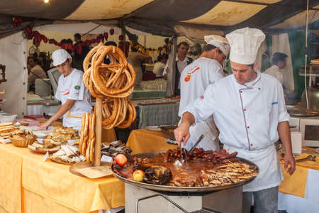 VARAZDIN, CROATIA - SEPTEMBER 2, 2007   Professional cook cooking during on the stand Spancirfest festival  It is street festival held every year since 1999 and lasts for 10 days, hosting over 100,000 tourists  Editorial
