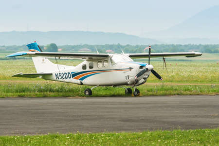 cessna: ZAGREB, CROATIA - JULY 18, 2008: Cessna P210N Centurion parked on a grass airfield Lucko. It is six-seat, single-engined general aviation aircraft, first flown in January 1957 and produced by Cessna until 1985.