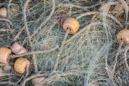 fishermans net: Nylon fishing net on the heap, closeup view