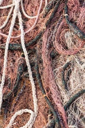 fishermans net: Pink fishing net on the heap, closeup view
