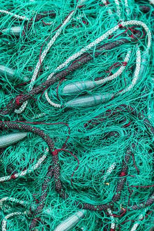 fishermans net: Green fishing net on the heap, closeup view