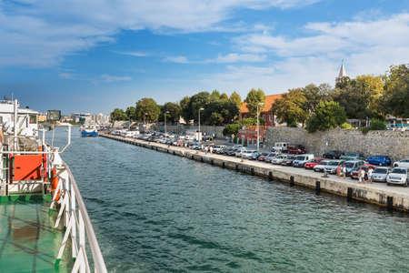 ZADAR, CROATIA - AUGUST 21, 2014: Jadrolinija car ferry arriving to Zadar old city port. Jadrolinija is state-owned with main mission in connecting Croatian islands to the mainland.