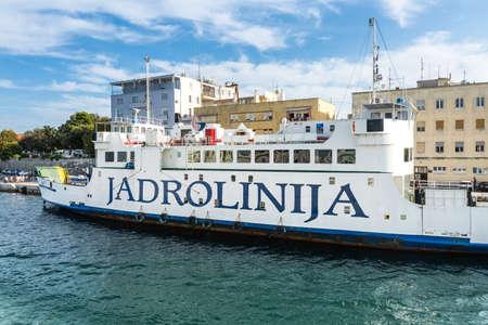 ZADAR, CROATIA - AUGUST 21, 2014: Jadrolinija car ferry docked at Zadar old city port. Jadrolinija is state-owned with main mission in connecting Croatian islands to the mainland. Editorial