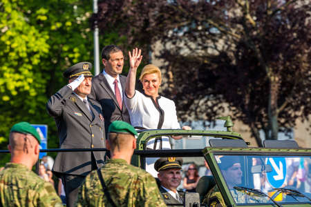 minister of war: ZAGREB, CROATIA - AUGUST 4, 2015: Croatian president Kolinda Grabar Kitarovic with minister of defense Ante Kotromanovic and Army Chief of Staff Drago Lovric greeting soldiers during military parade held in celebration of 20th anniversary of liberation of