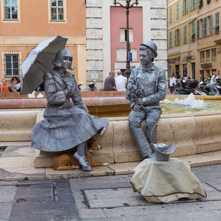 alpes maritimes: NICE, FRANCE - AUGUST 16, 2015: Mime artists on performing on the streets of Nice. Nice is 5th most populous city in France and capital of Alpes Maritimes department.