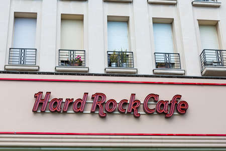 hard rock cafe: NICE, FRANCE - AUGUST 16, 2015: Hard rock cafe logo above entrance to the restaurant in Nice. It is a chain of theme restaurants founded in 1971 by Americans Isaac Tigrett and Peter Morton in London.
