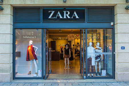front of: AIX-EN-PROVENCE, FRANCE - AUGUST 14, 2015: Zara shop on the Boulevard de la Republique. It is Spanish clothing and accessories retailer based in Arteixo, Galicia, and founded in 1975 by Amancio Ortega and Rosalía Mera Editorial