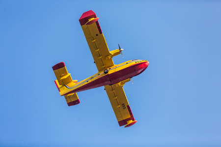 bombardier: ZAGREB, CROATIA - AUGUST 4, 2015: Bombardier 415 Superscooper formerly Canadair CL-415 SuperScooper flying during Zagreb military parade. Its a Canadian amphibious aircraft purpose-built as a water bomber. Editorial