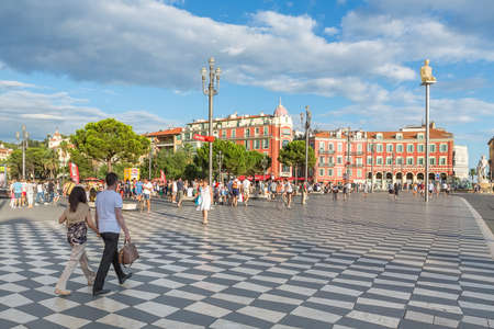 nice: NICE, FRANCE - AUGUST 16, 2015: People walking on streets of Nice. Nice is 5th most populous city in France and capital of Alpes Maritimes department.