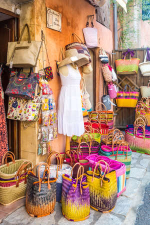 roussillon: ROUSSILLON, FRANCE - AUGUST 11, 2015: Street shop with womens accessories - wedding dress and bags displayed on the stand. Editorial