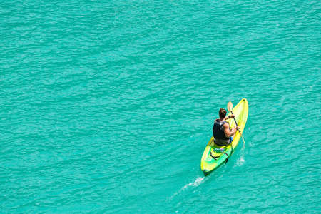 kilometres: Man kayaking and recreating in Verdon Gorge, on mouth of Le Verdon river, near Aiguines. Canyon is about 25 kilometres long and up to 700 metres deep. Stock Photo