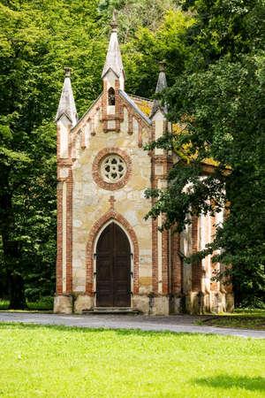catholic chapel: Catholic chapel in a forest Stock Photo