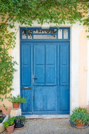 french doors: Blue wooden doors in Saint-Saturnin-les-Apt, French village in Provence