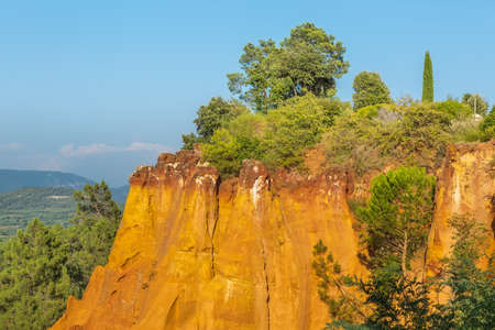 roussillon: Ochre rocks in Roussillon, France - a popular tourist destination for hiking, with magnificent view at Provence