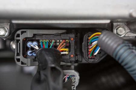 Electric conectors - engine of a hybrid car engine powered both by electric battery and gas 스톡 콘텐츠
