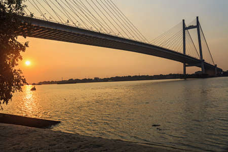Cable bridge (Vidyasagar Setu) on the river Hooghly at sunset (Silhouette view)