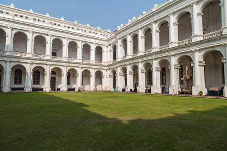 calcutta: KOLKATA, INDIA - NOVEMBER 8, 2016: Historic Indian museum gothic architectural building at Kolkata, India inner compound as viewed from the ground floor.