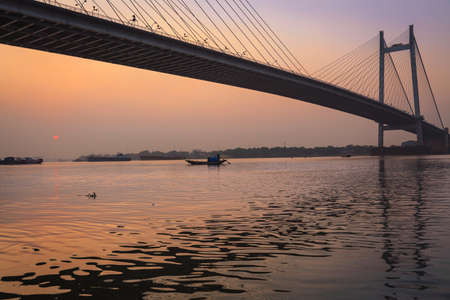 hooghly: Vidyasagar Setu the longest cable bridge on the river Hooghly at sunset (Silhouette view) Stock Photo