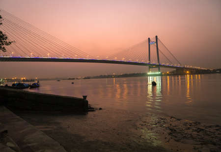 hooghly: Vidyasagar setu (bridge) on river Hooghly at twilight time. Also known as the Second Hooghly bridge it is the longest cable stayed bridge in India.